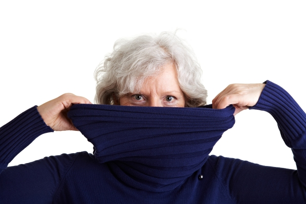Senior Woman Looking Over Turtleneck Sweater